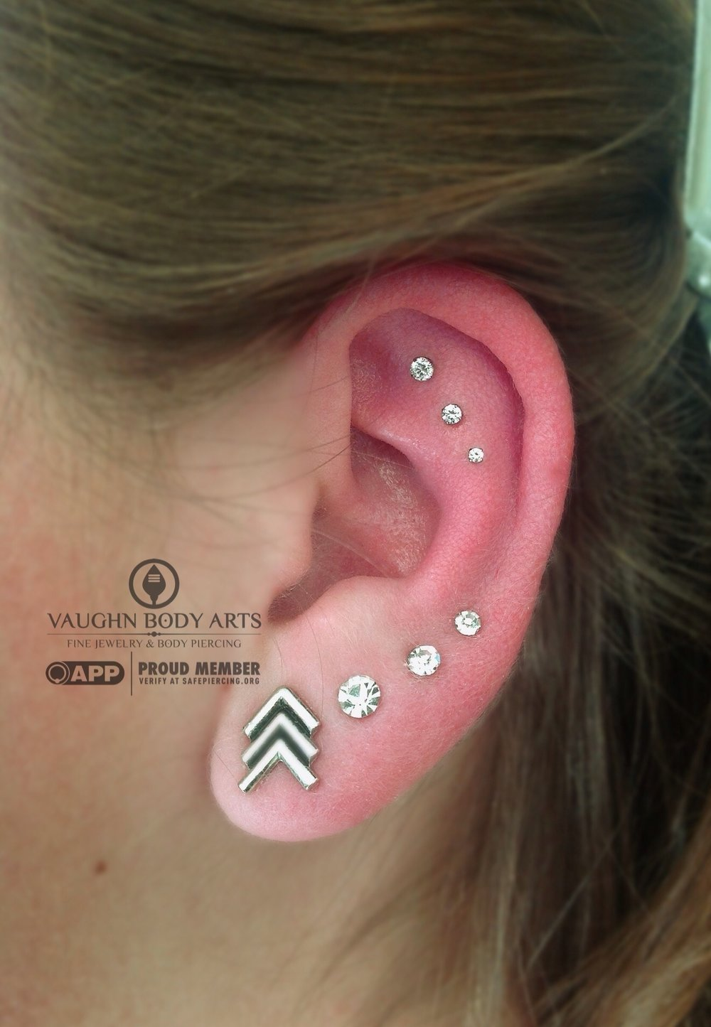 Triple helix piercings with titanium jewelry from NeoMetal.