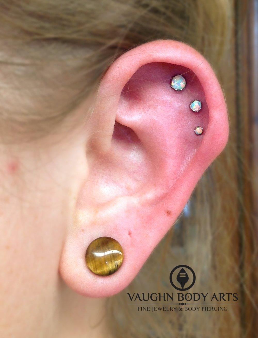 Triple helix piercings with titanium jewelry from Anatometal.