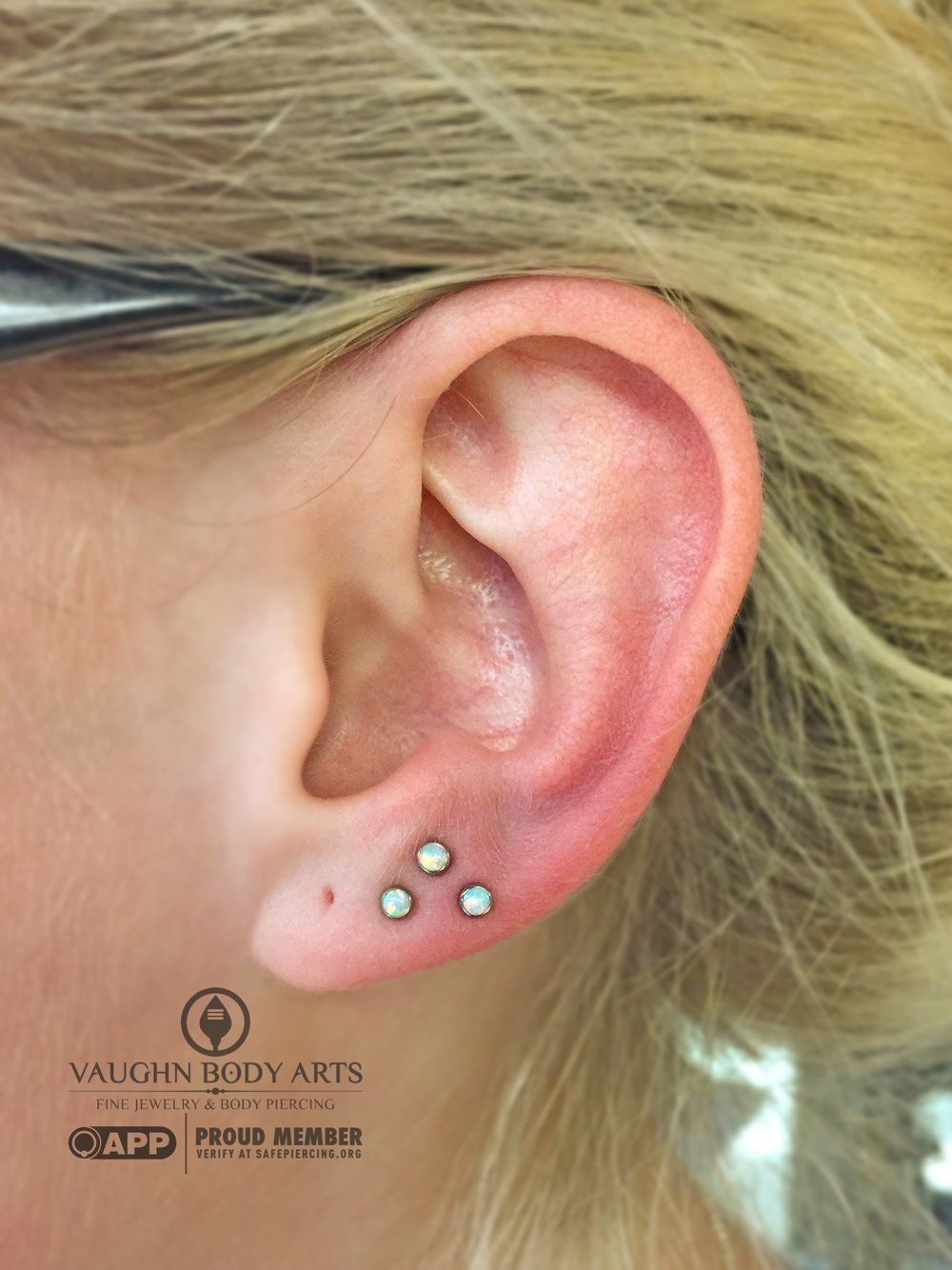 Triple earlobe piercings with titanium jewelry from Anatometal.