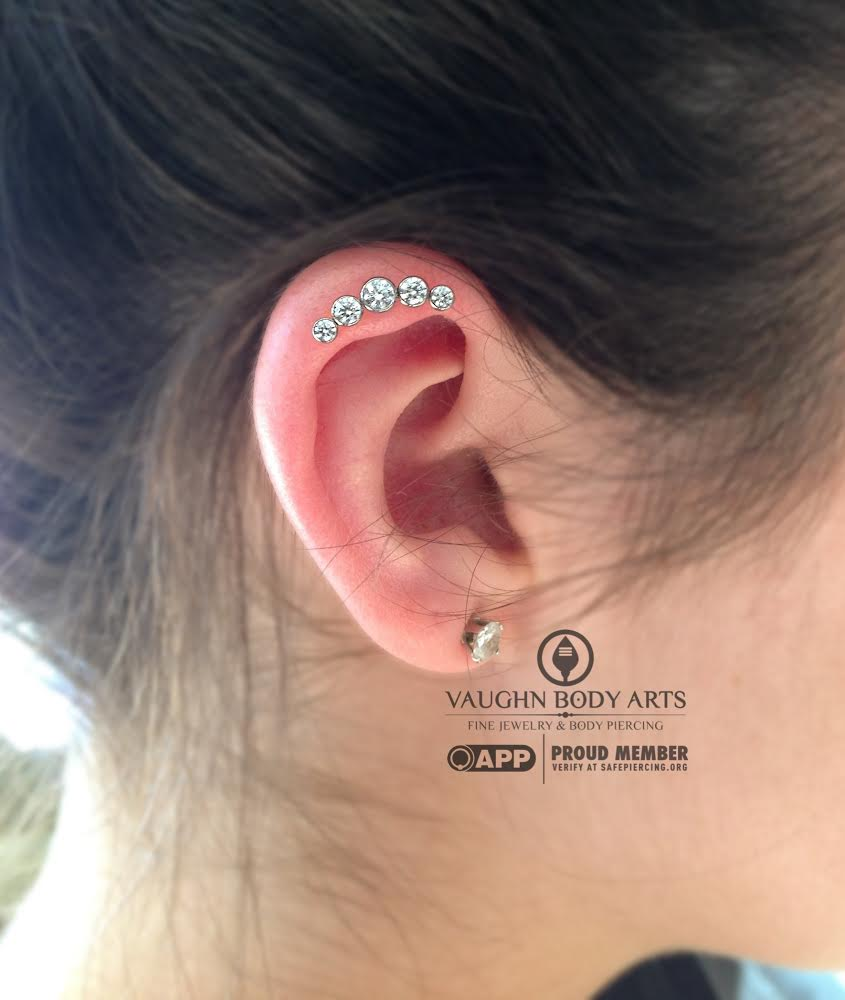 Helix piercing with titanium gem cluster from Anatometal.