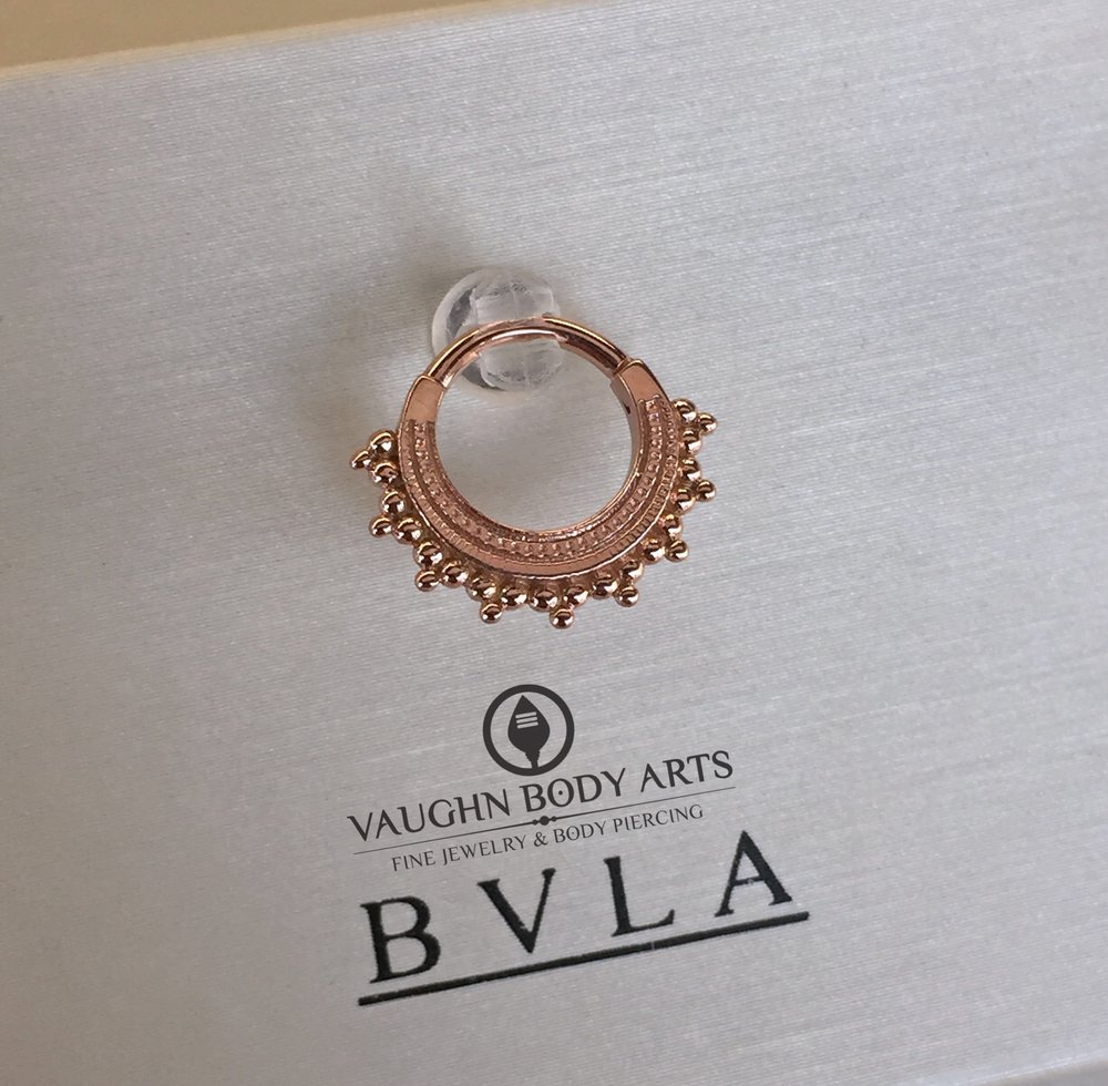 "14k rose gold ""Afghan"" clicker from BVLA."