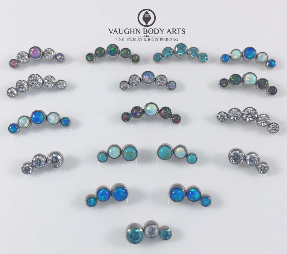 Selection of titanium 3 and 5 gem clusters from Anatometal.