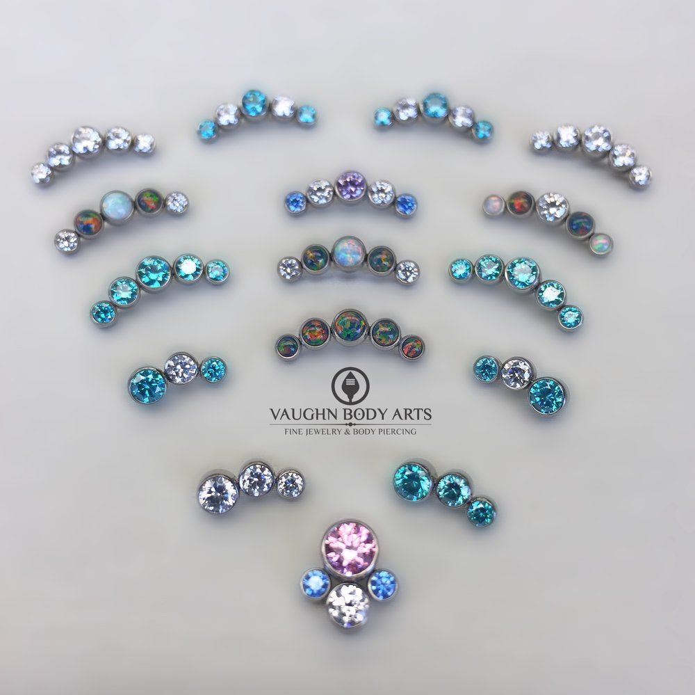 Selection of titanium 3, 4 and 5 gem clusters from Anatometal.