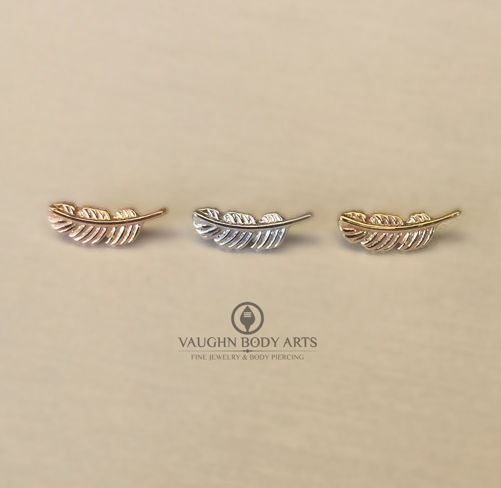 Feather ends in 14k rose, white, and yellow gold from BVLA.