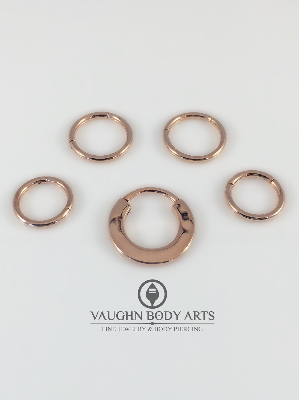 Selection of rose gold clickers from Le Roi.