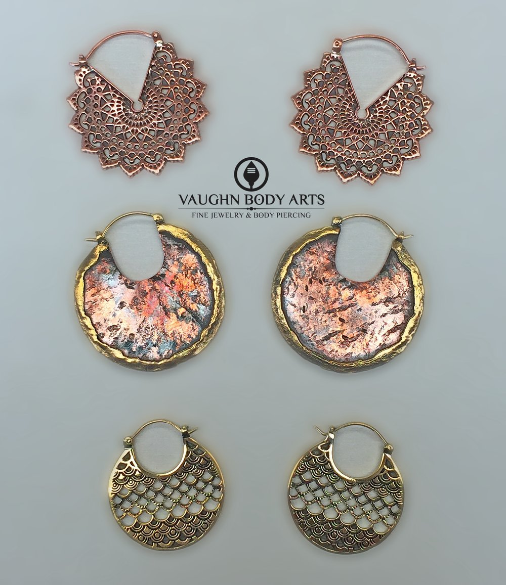 "Selection of earrings from Maya Jewelry, from top to bottom;  ""Majesty Black"" in copper, ""Road Warrior"", and ""Sirens"" in brass."