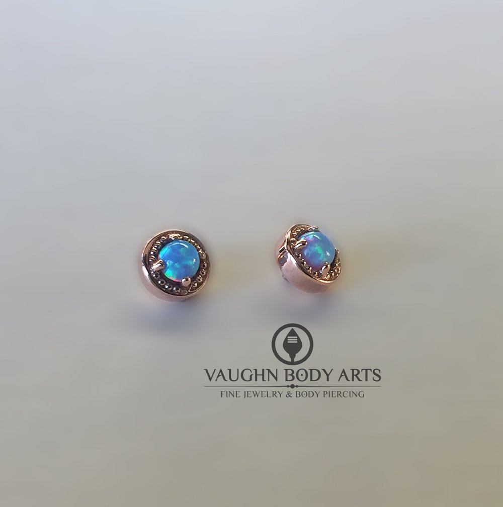 "14k rose gold prong ""Millgrain"" ends from BVLA featuring genuine light blue opals."