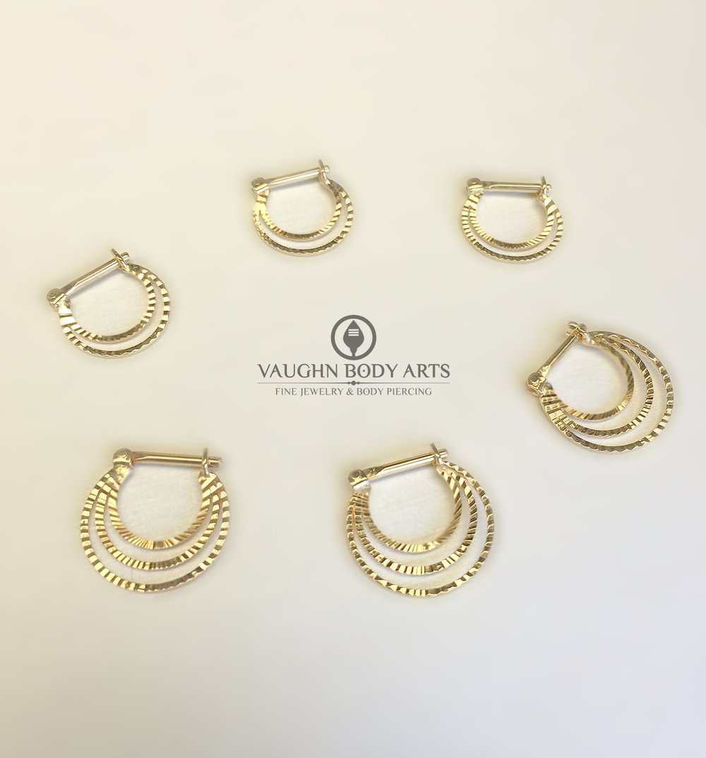 Selection of 14k yellow gold clickers from Quetzalli Jewelry.