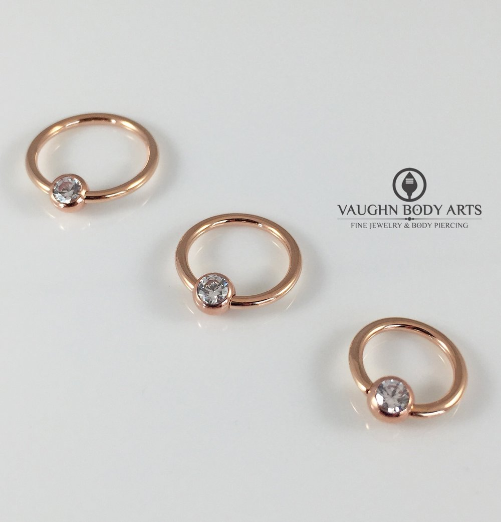 18k rose gold captive bead rings from Anatometal.