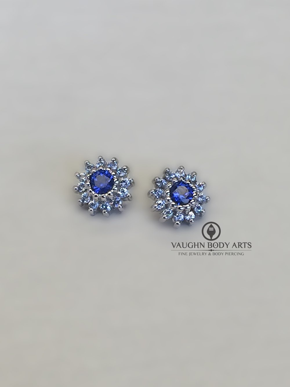 "14k white gold ""Rose"" ends from BVLA featuring light and dark blue cz's."