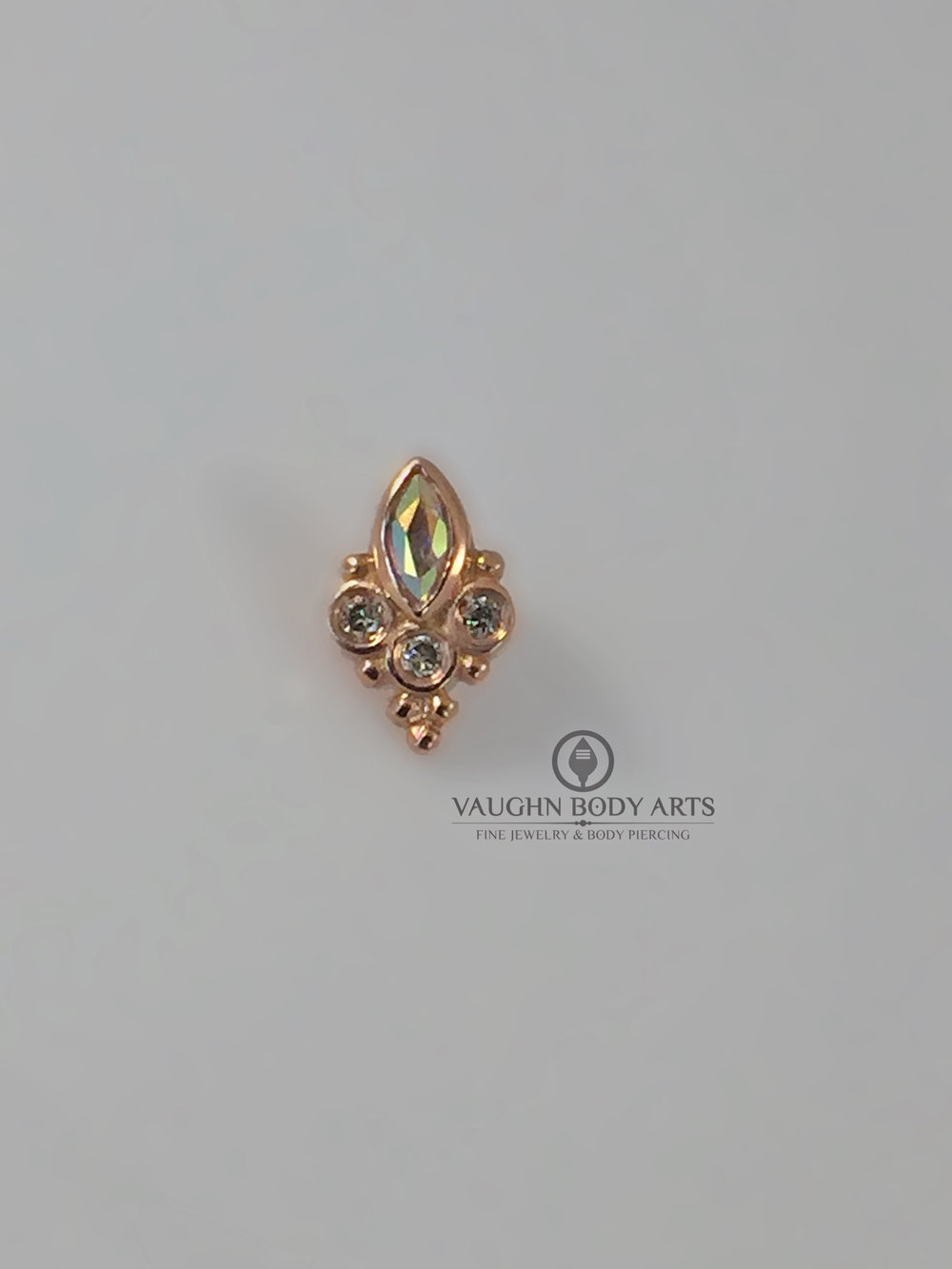 """Marquis Sarai"" end from BVLA in 14k rose gold featuring mercury mist topaz."