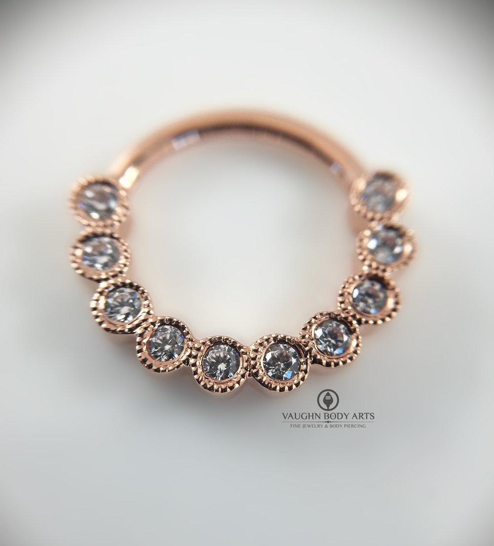 "14k rose gold scalloped-edge ""Eternity"" clicker from Maria Tash featuring clear cz's."