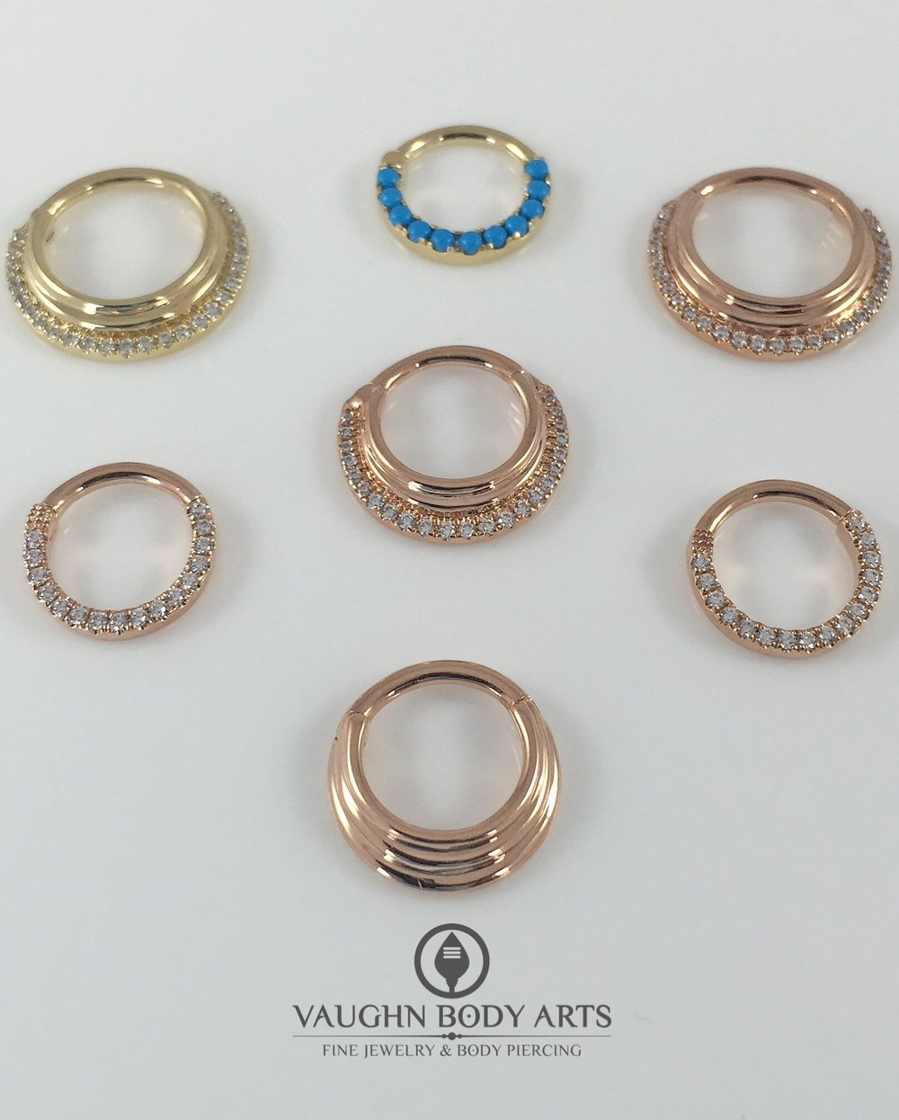 Selection of 14k rose and yellow gold clickers from Maria Tash.