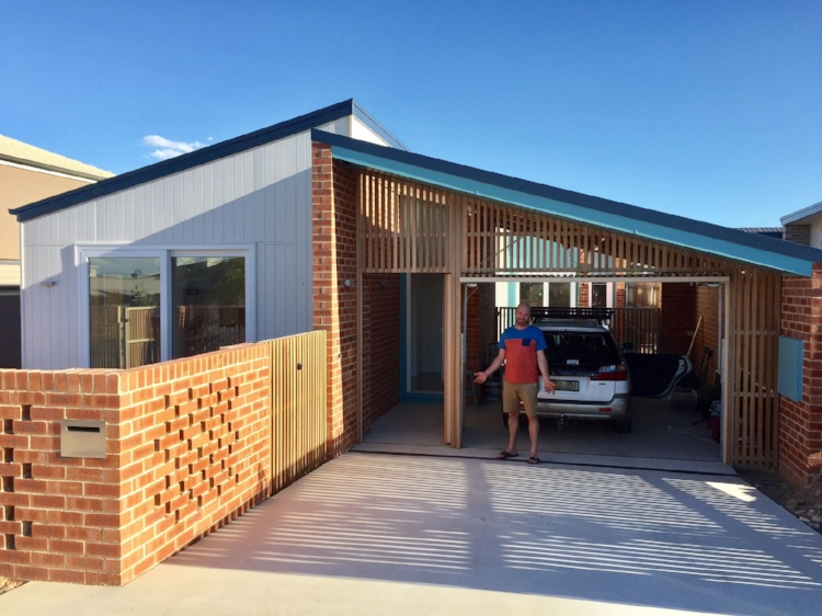 Jenny's partner after driving into the carport for the first time! Sun-smart pergolas and landscaping now underway.