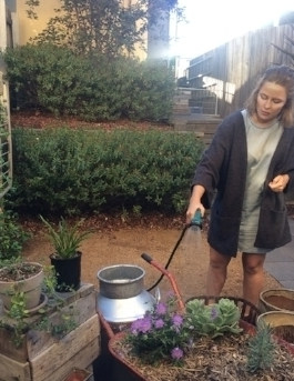 Rachel ensuring her portable, beautiful and functional garden continues to thrive.