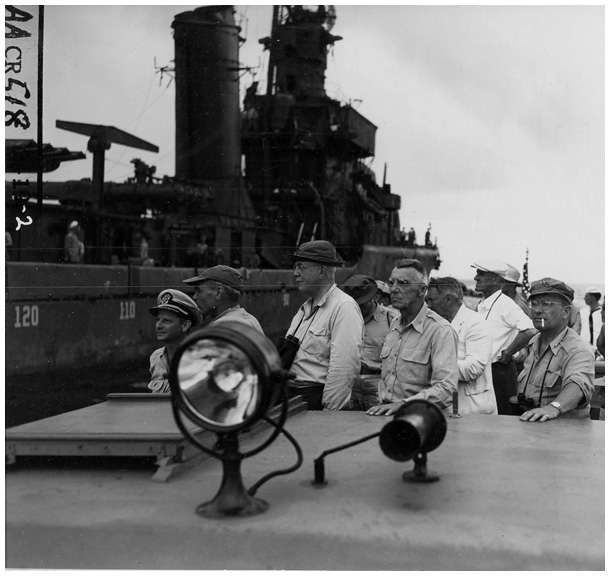Members of the Joint Chiefs of Staff's Evaluation Board looking over the damaged fleet on July 3, 1946, accompanied by Captain Horacio Rivero of the Navy' s Special Weapons Staff, who had played a key role in selecting Bikini. Shown in the photo from left to right are: Rivero, Vice Admiral John H. Hoover, Bradley Dewey, General Joseph W. Stilwell (after his death replaced by General Albert C. Wedemeyer), Lt. General Lewis H. Brereton. (NARA, Still Pictures Unit, Record Group 80-G, box 1724, folder 627483-627519)