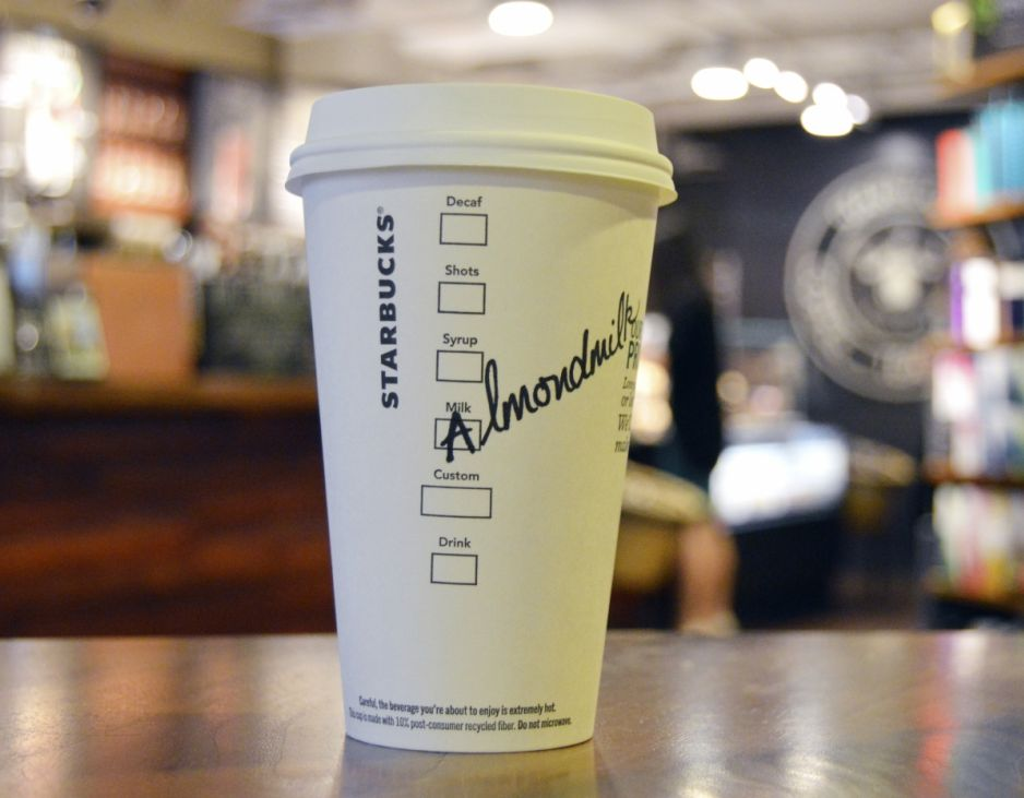 Starbuck s has officially introduced almond and coconut milk to all locations. Photograph: Starbucks.
