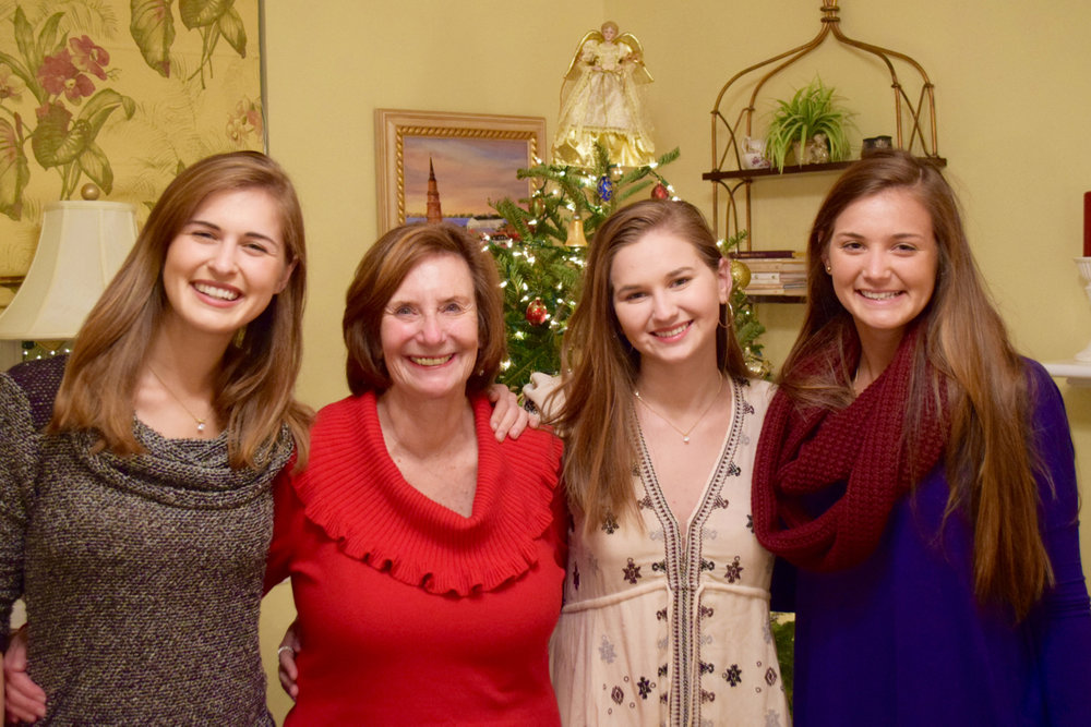Christmastime with Oma and my younger sisters, Molly and Marin (left to right).