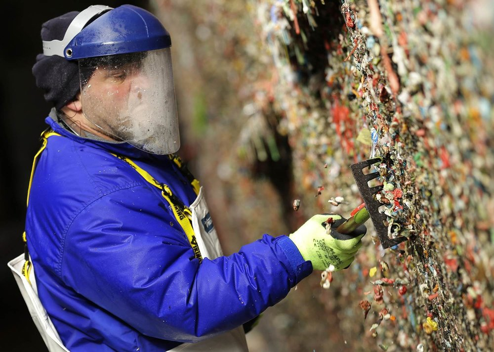 Look - no one actuallylikes posing for a photo at the gum wall. No one. - City Workers Cleaning Seattle's Gum Wall,courtesy of the Odyssey Online.