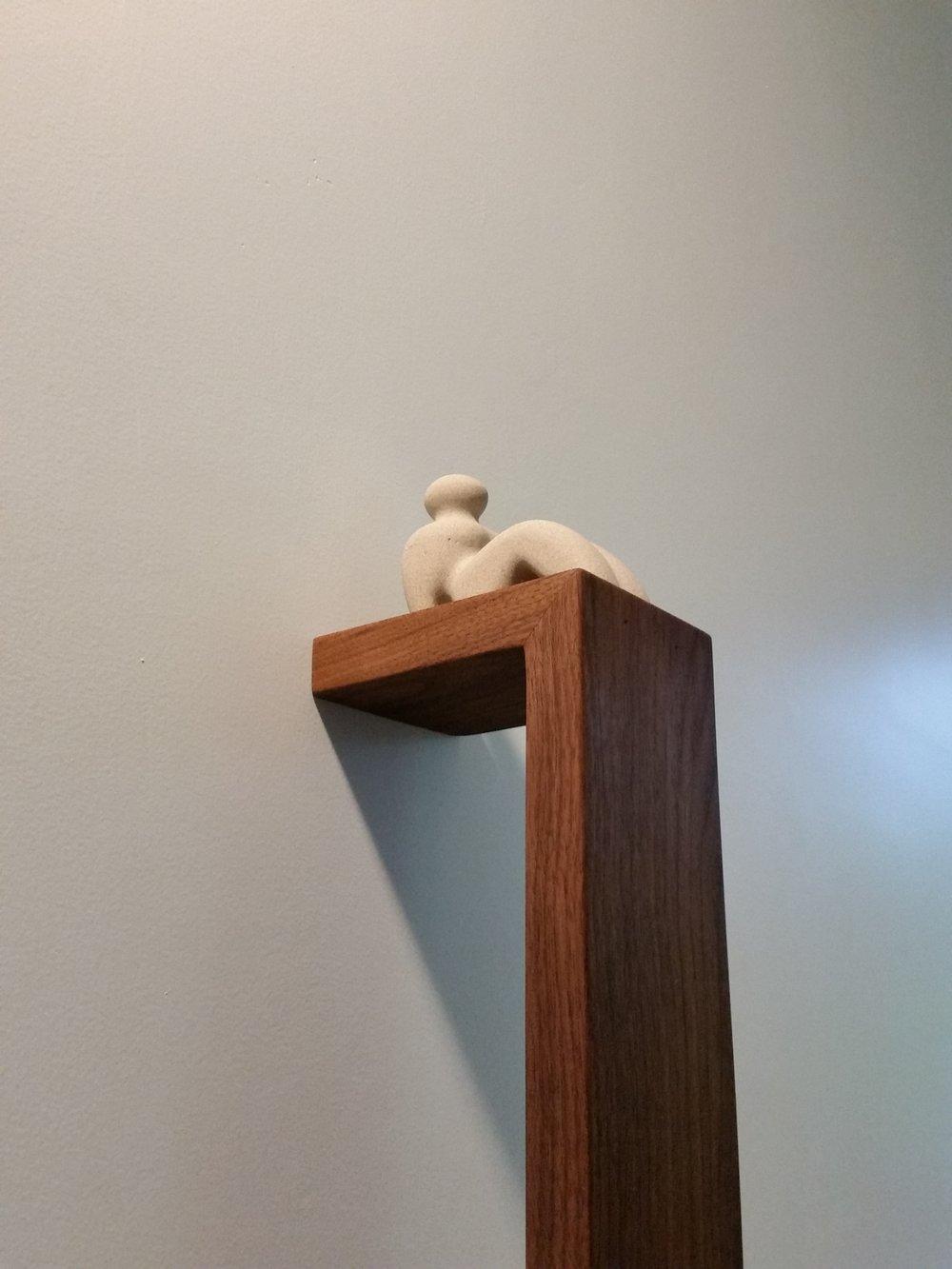 Livin' on the Ledge - limestone figure on walnut