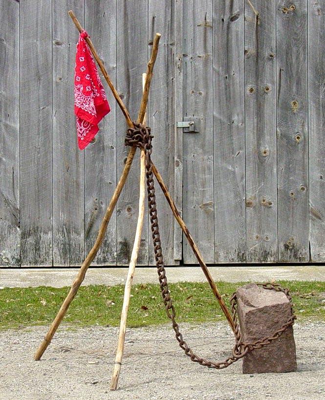 Bound by the Future - sticks, bandana, chain, brownstone chunk