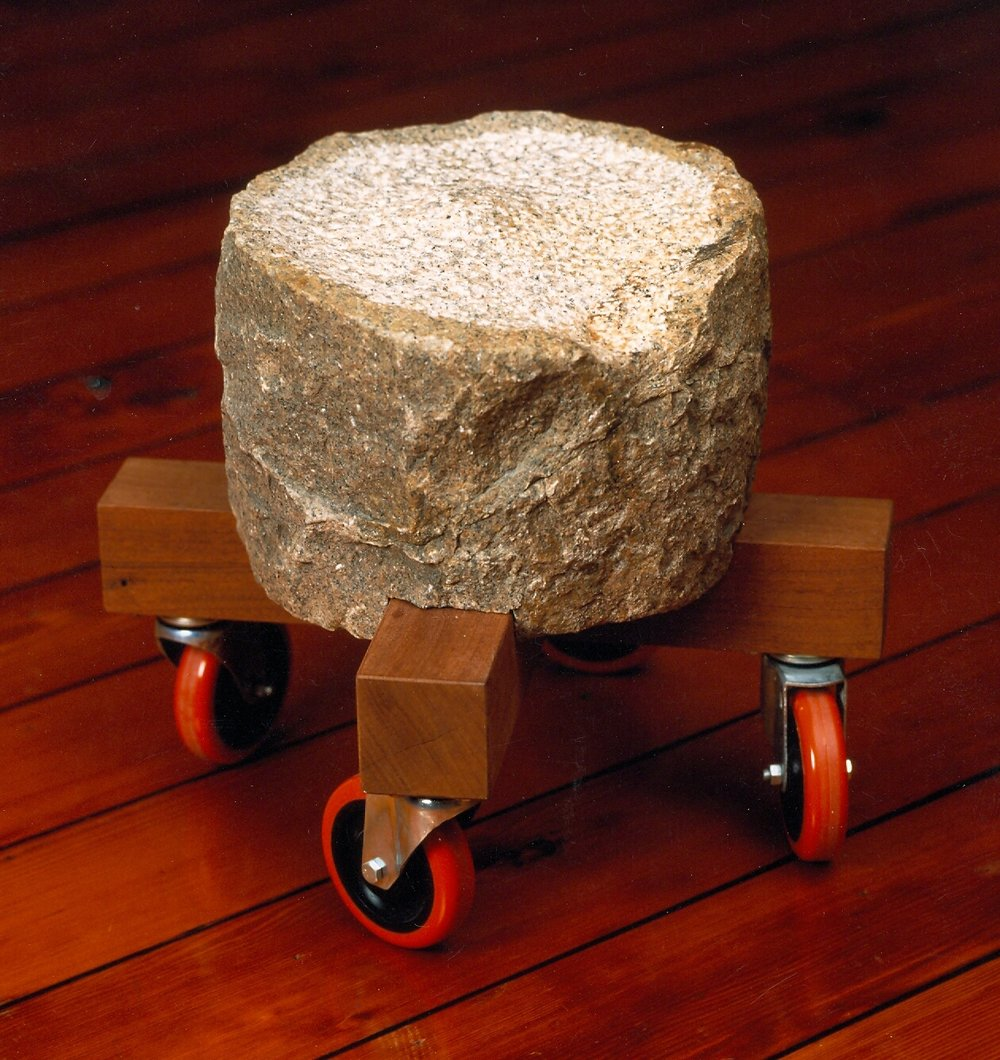 Rolling stone stool - salvaged granite, mahogany, casters