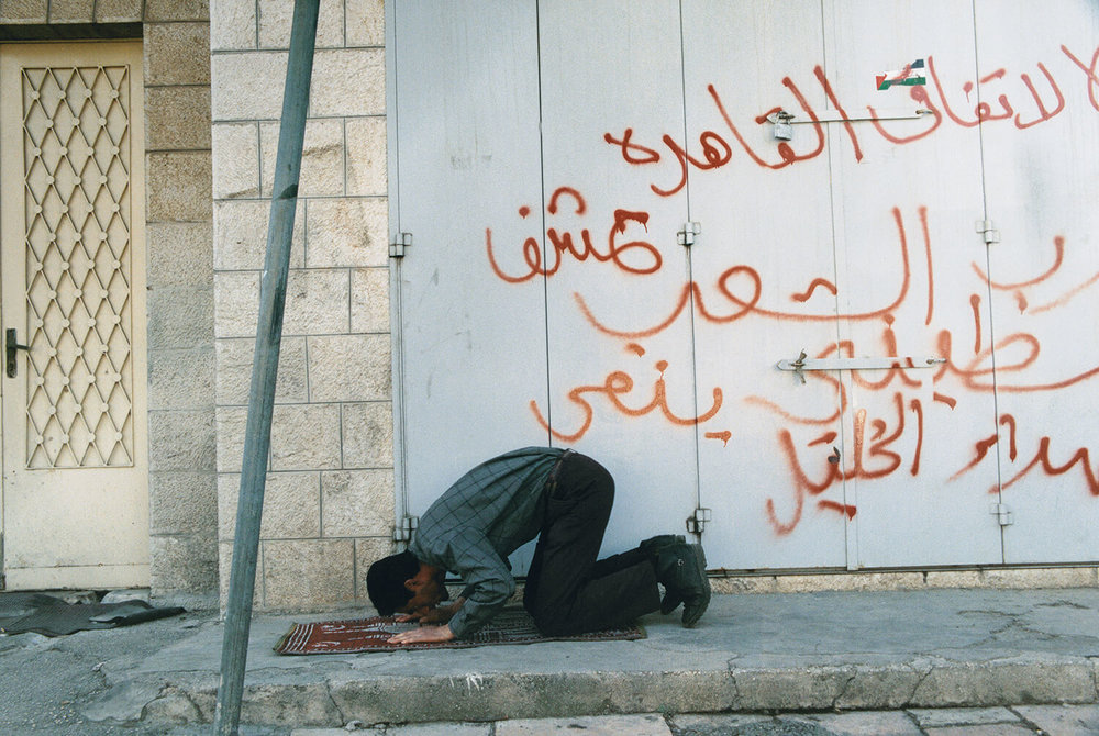 Muslim in prayer on a street in east Jerusalem.