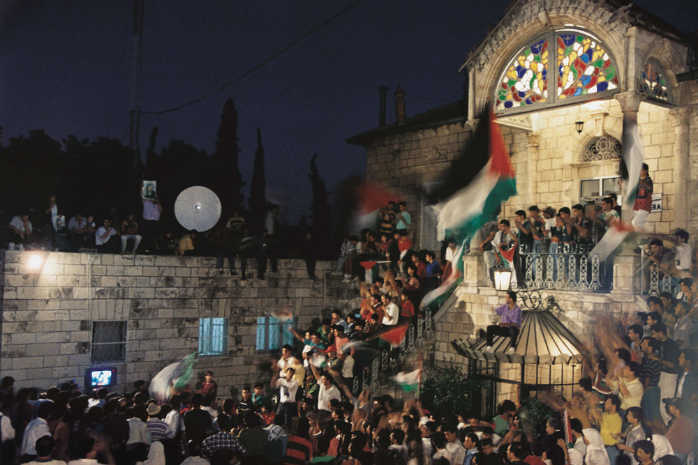 September 13, 1993. At the Palestinian headquarter, Orient House, Palestinians gathered to celebrate the peace agreement.