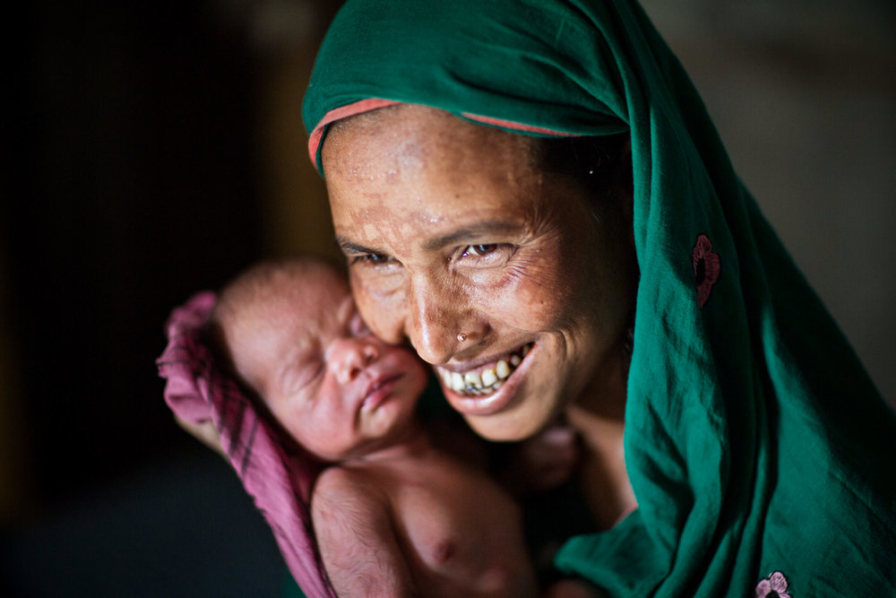 Bangladesh. Ruma Akhter, 22 years, with her little daughter Tanni 3 days old.