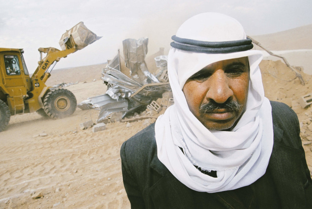 Israeli authorities demolish Bedouin's house.