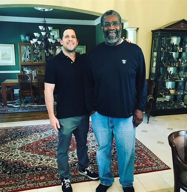 "My favorite thing that came out of writing ""Mean"" Joe Greene's book is my friendship with the man himself. Had a great visit with Mr. Greene today and even happier to help him with a great cause he's involved in. You never know who you'll hit it off with and who knew one day I'd talk Bill Russell, Larry Bird and the Celtics with the best Pittsburgh Steeler of all time. Very cool and very humbled. And looking very small! I'm almost 200 lbs and I look like a little kid in this pic.😂💪🏼👊🏻"