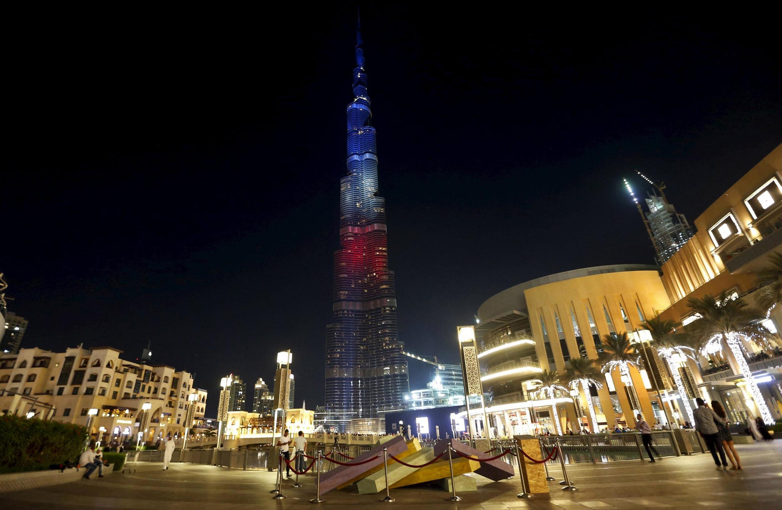 Burj Khalifa, the tallest tower in the world, is seen lit up in blue, white and red, the colours of the French national flag, following the Paris attacks, in Dubai