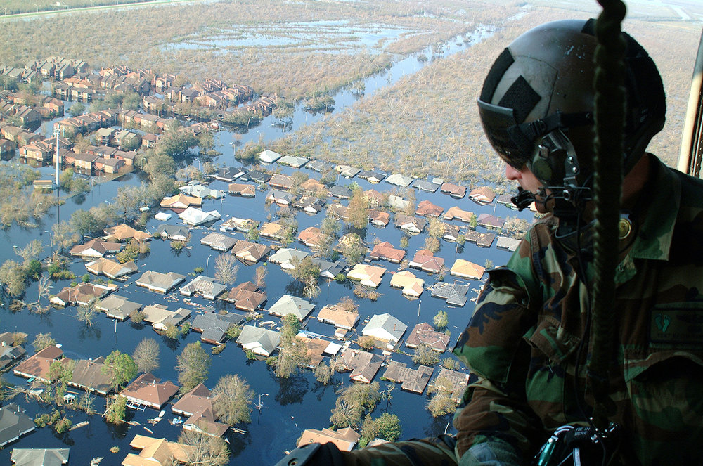 Soldier surveys destruction wrought by Hurricane Katrina. Source: hearttoheart.org