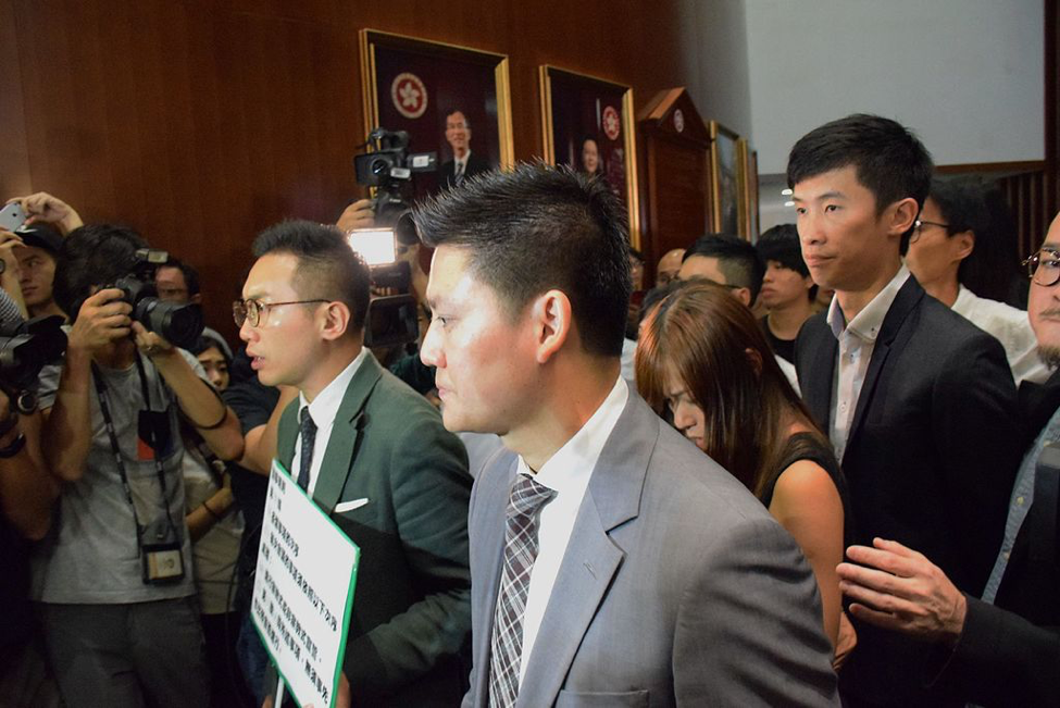 Pro-Democratic lawmakers form a circle to allow Yau and Leung to enter LegCo after their oaths were rejected. Source: Wikimedia commons