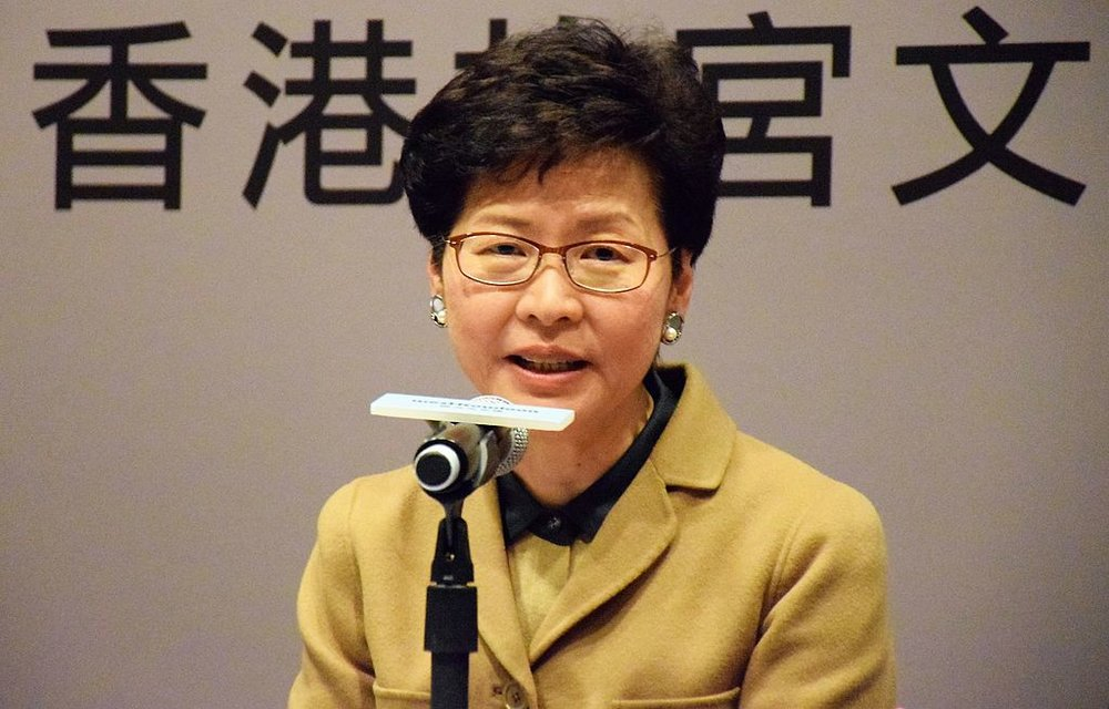 Carrie Lam speaking at a press conference about the Palace Museum controversy. Source:  Wikimedia