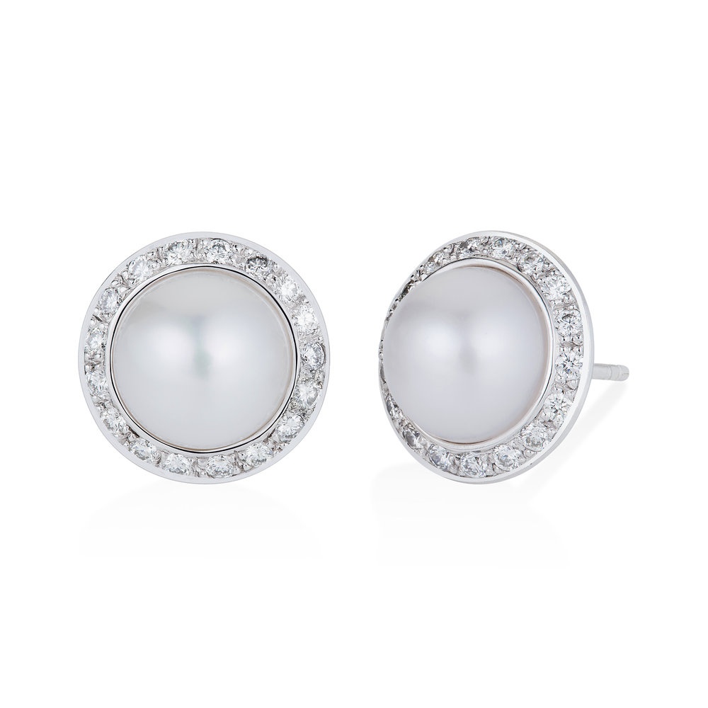 oversized pearl earrings.jpg