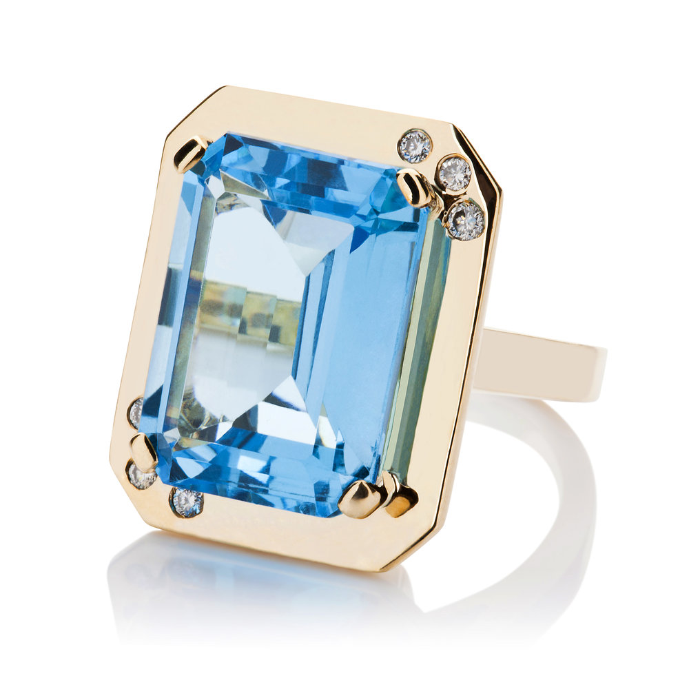 Blue Topaz and diamonds in gold cocktail ring.jpg