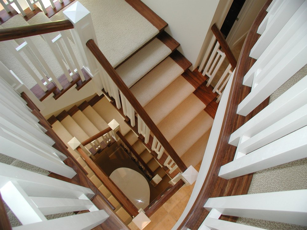 Spiral Staircase with light carpet runner