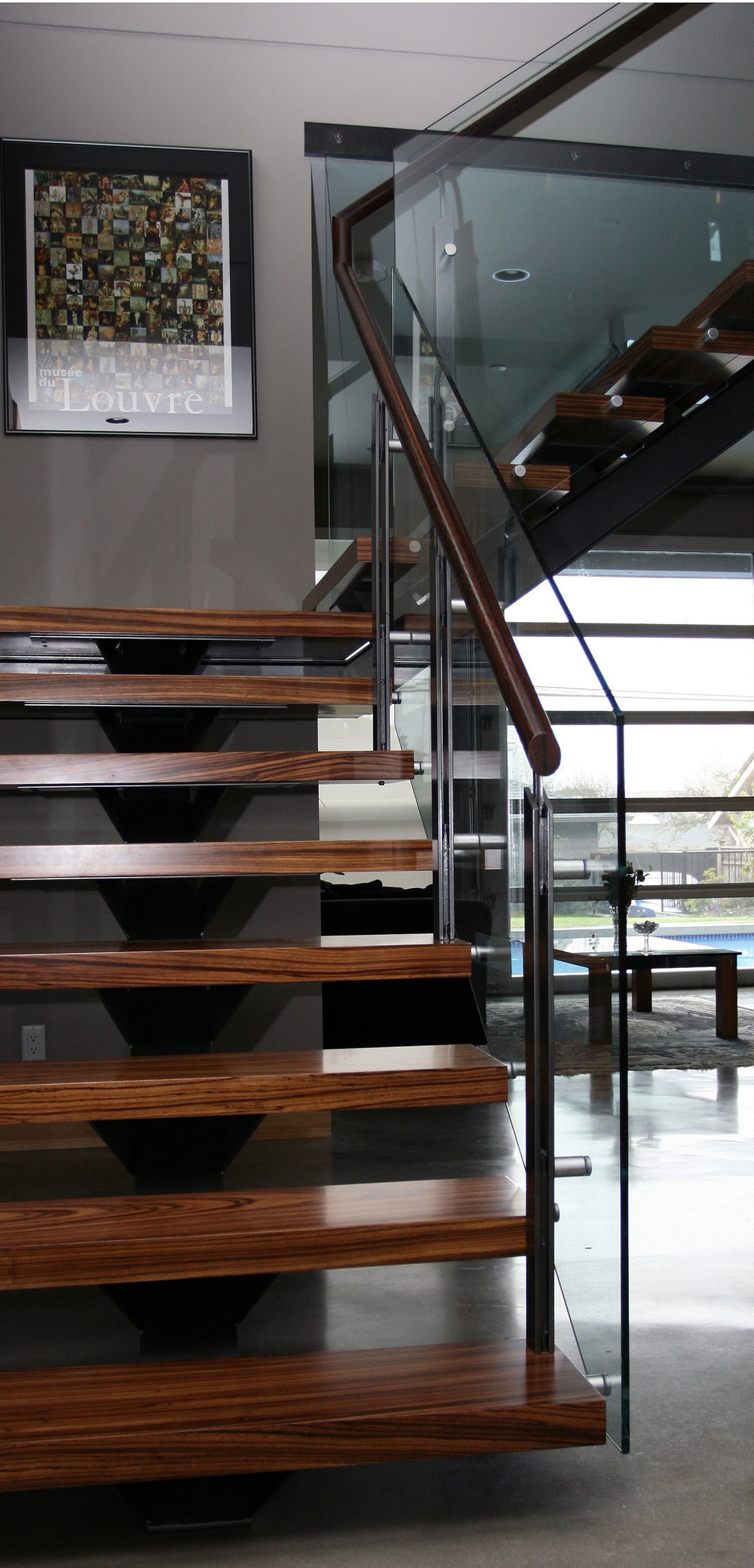Wood and metal floating stair case style