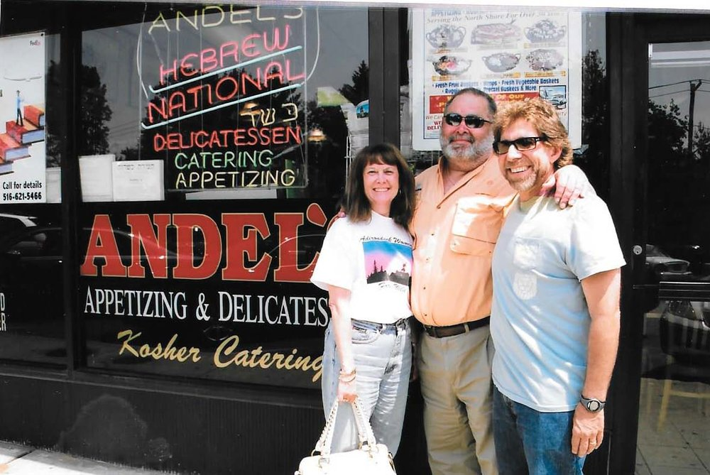 40th high school reunion: Margie Sternin Bloomberg, Mitch Bloomberg, and Mitch Kaplan, in front of Andel's