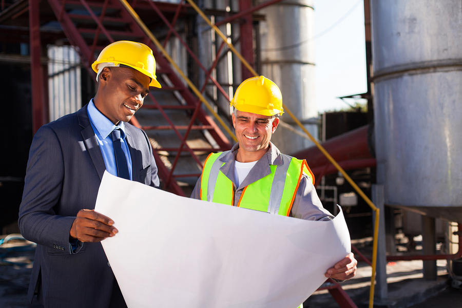 bigstock-industrial-engineers-standing--47414227.jpg