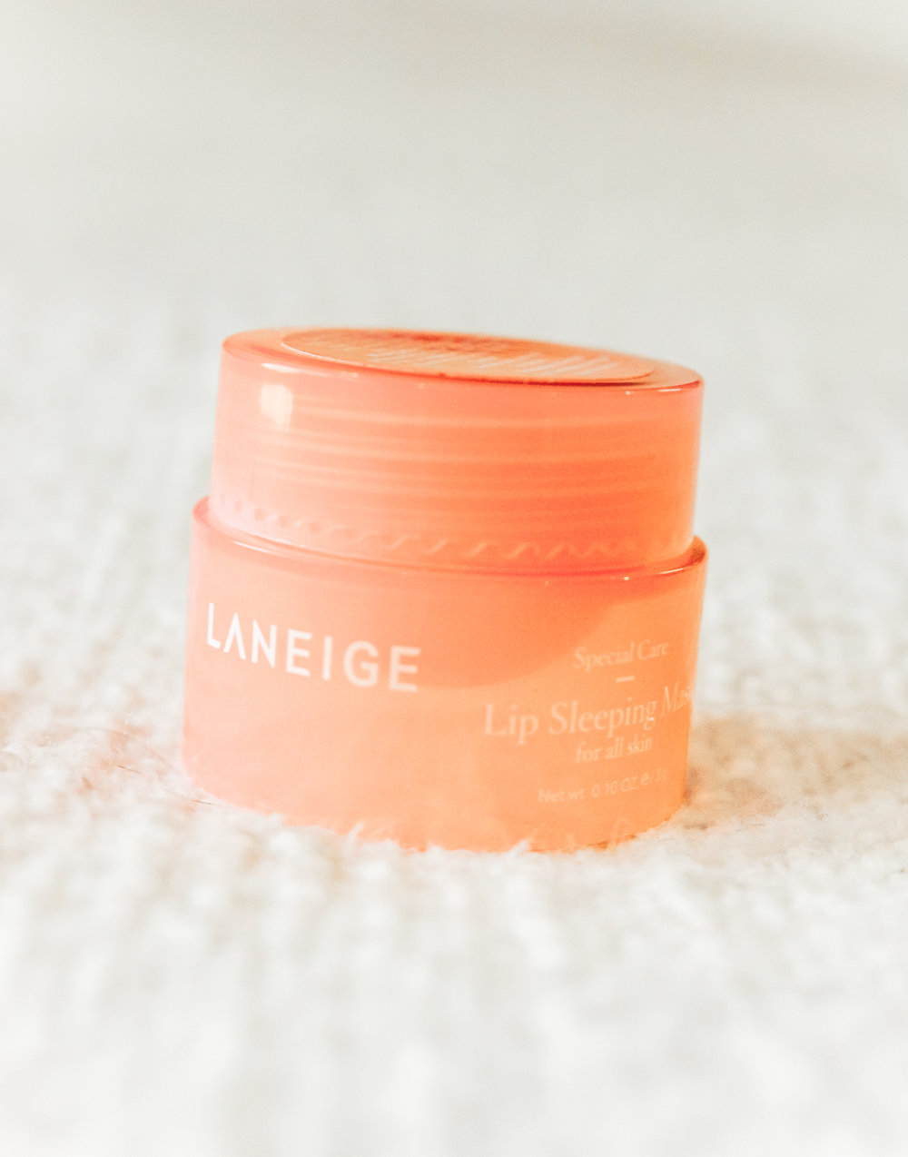 Laneige Lip Sleeping Mask: - Laneige Lip Sleeping Mask: y'all this stuff is seriously magical. I received a sample of this about a month ago and have been using it consistently ever since. I can't even explain how much it has improved the texture and overall hydration of my lips! I hardly use chapstick anymore because I don't really need it now! Chris uses this every night too and loves it.If you're gonna buy anything during the sale, buy this!