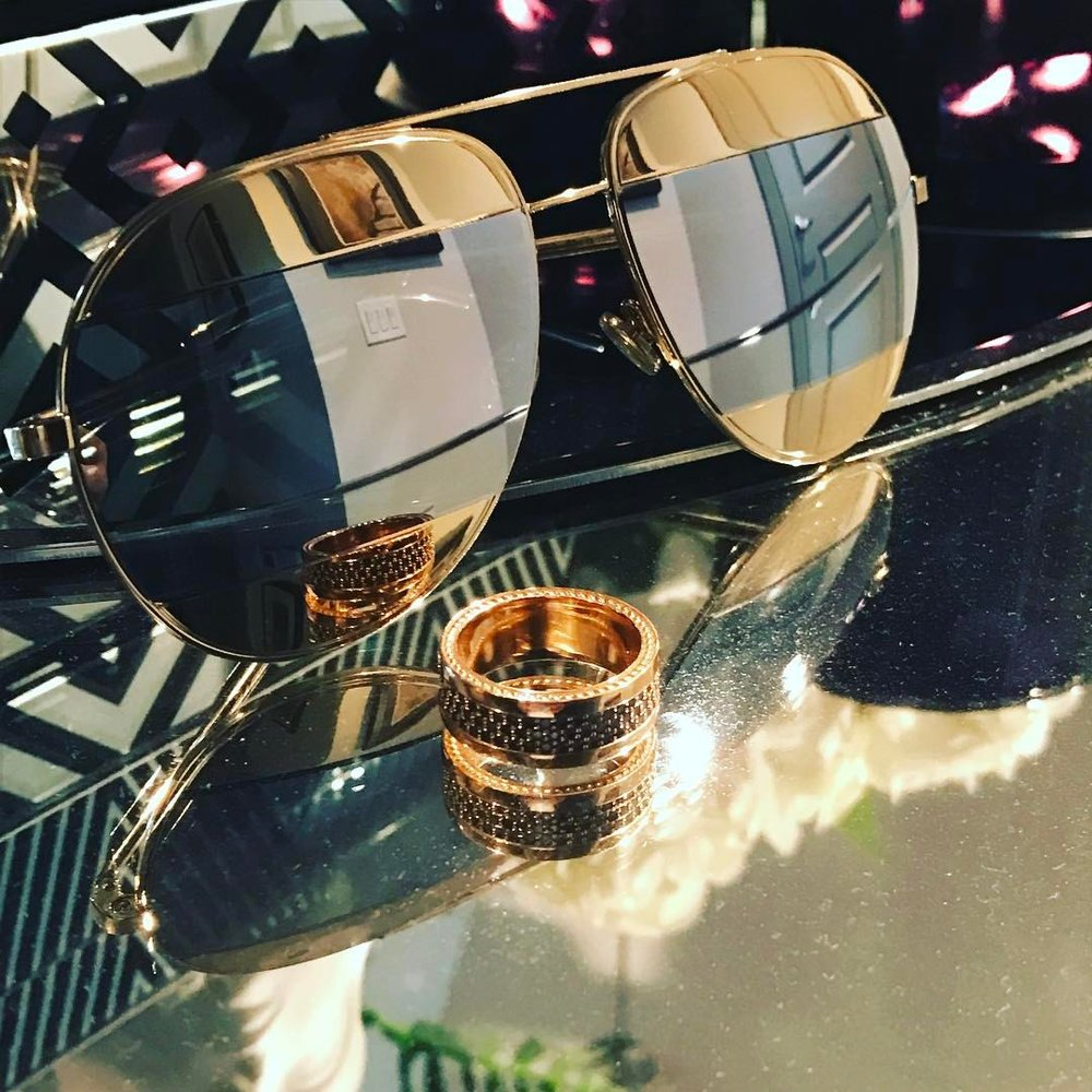 D I O R x 5 9 F A C E T S - GUIDED BY THE INSPIRATION OF THE DIOR FASHION HOUSE, OUR MASTER CREAFTSMEN EXQUISITELY DESIGNED THIS 18K MENS RING ENCOMPASSING SOME OF THE FINEST COGNAC DIAMOND STONES. PAIRED WITH THE ICONIC DIOR SPLIT AVIATOR SUNGLASSES THESE TWO PIECES TRULY MAKE LIFE A BIT MORE ROSIE.