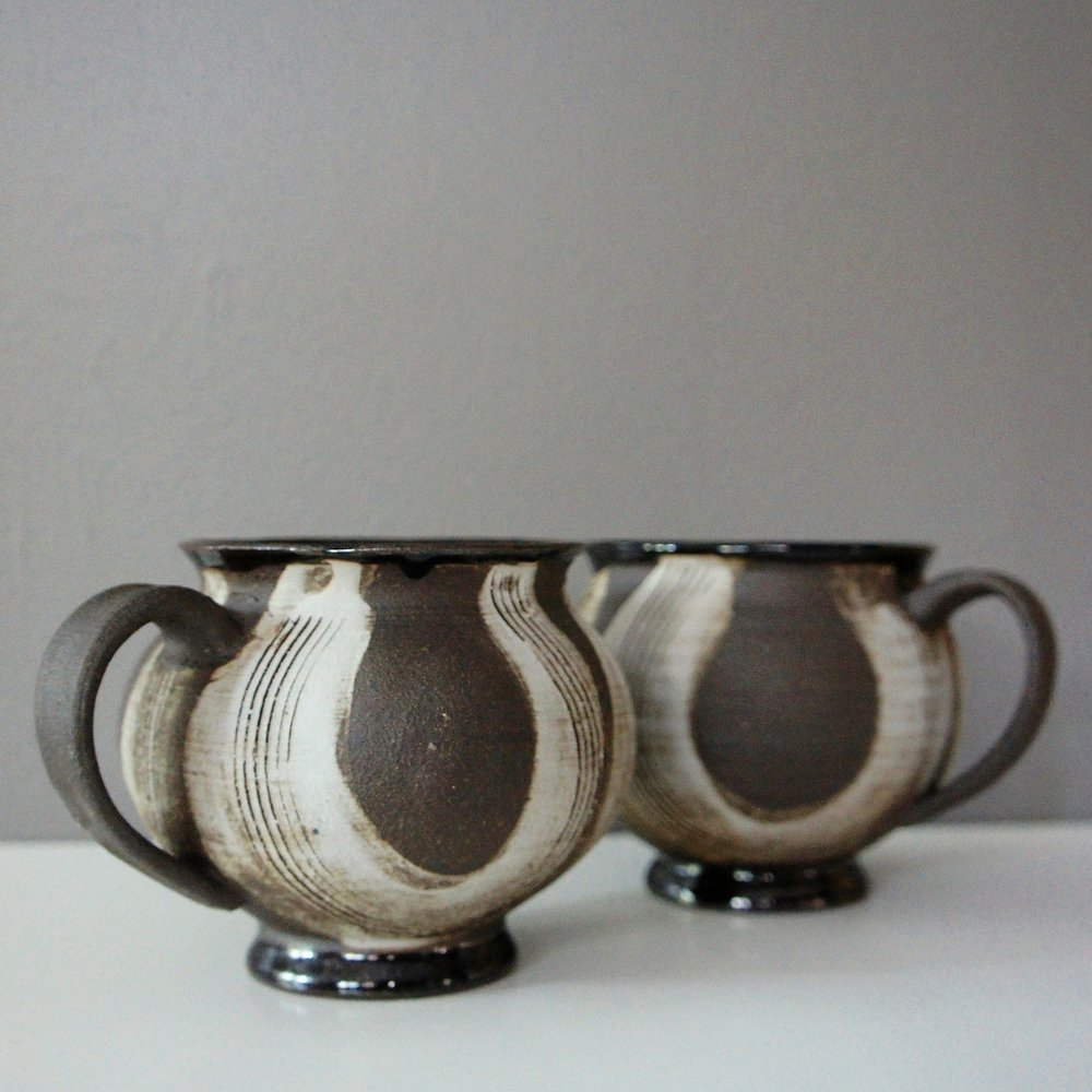 Hand Thrown and Altered Ceramic Mugs Retail Value: $70 Kay Yourist Shop more @Yourist Studio Gallery Holiday Sale