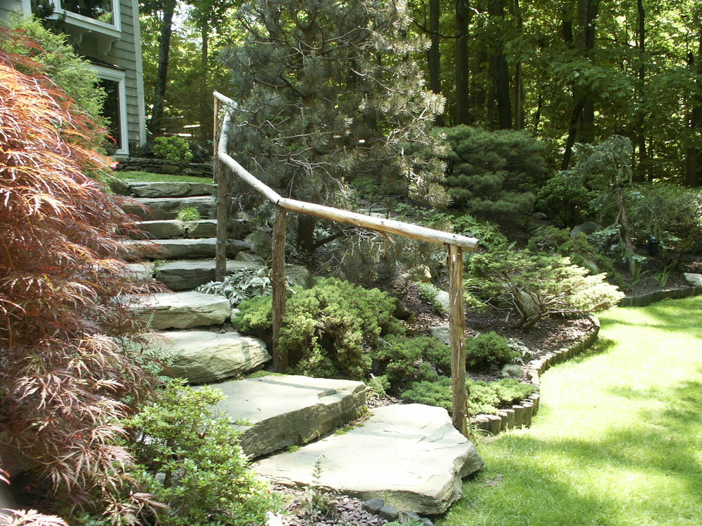 manmade pond, natural stone steps, and waterfall in Bedford, NY