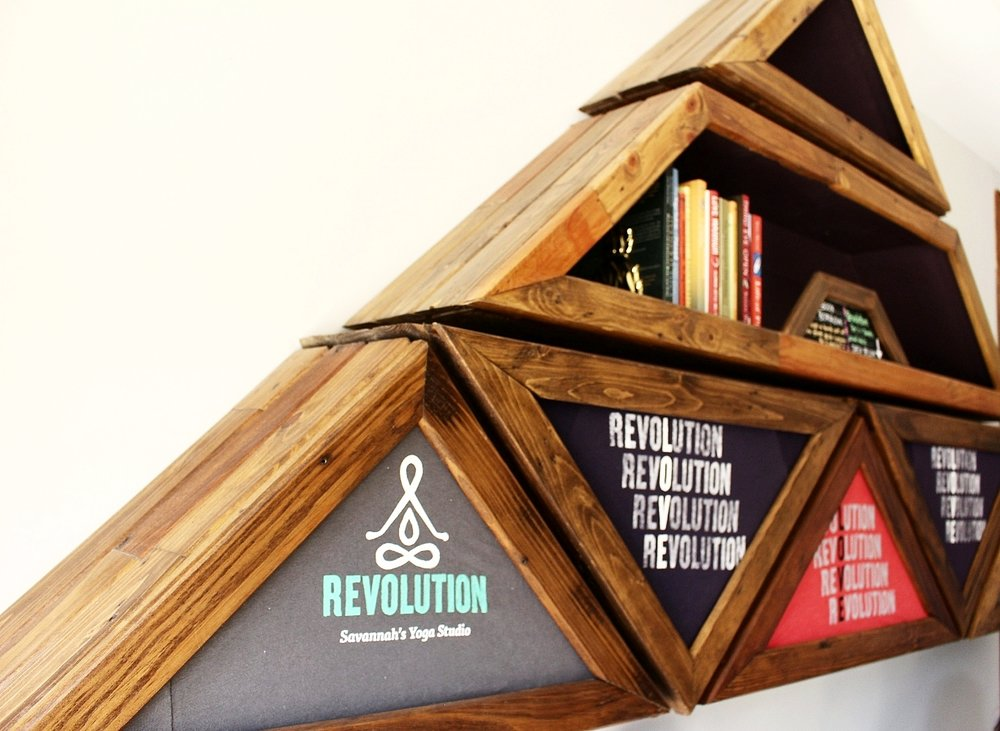 Mossing Studios designed this shelving-cum-wall art to display Revolution's tees and mini-library