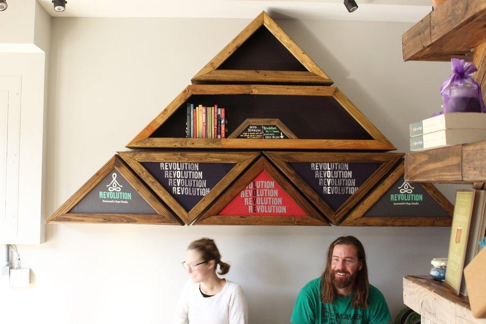 Custom shelving showcasing yoga merch maximizes wall space