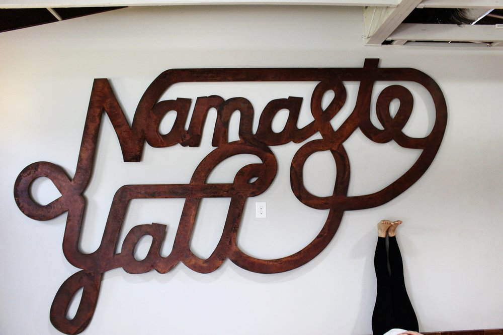 "Perhaps the crown jewel of the studio is this metal sign proclaiming, ""Namaste Y'all""- a tribute to the Savannah studio's southern locale."