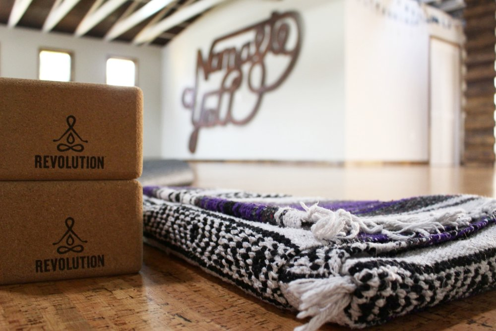 Revolution Yoga has cozy serapes, cork blocks, bolster pillows, lavender eye pillows, and even mats for student use.