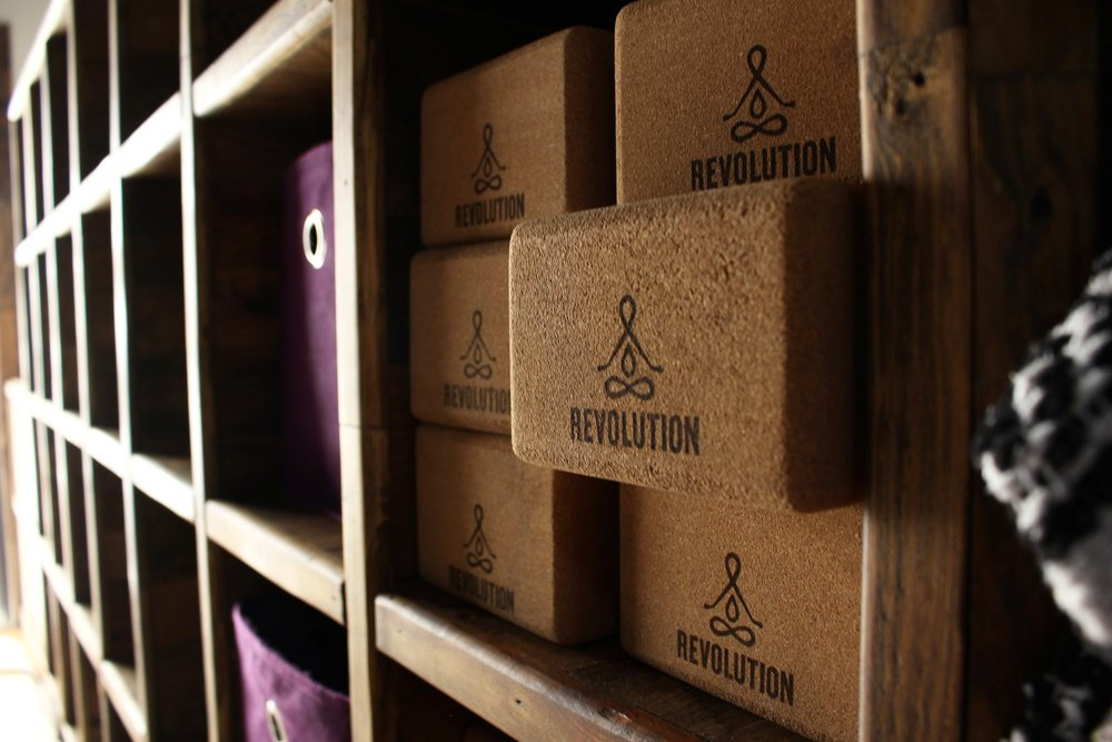 Revolution's props are stored along a far wall of shelving in the studio